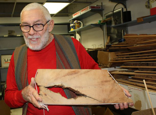 UA dendrochronologist Rex Adams holds up the innermost piece of the roughly 5,000-year-old tree, Prometheus. (Image by: Beatriz Verdugo/UANews)