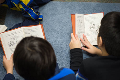 Students read at Bennett Woods Elementary School in Okemos. Photo by G.L. Kohuth