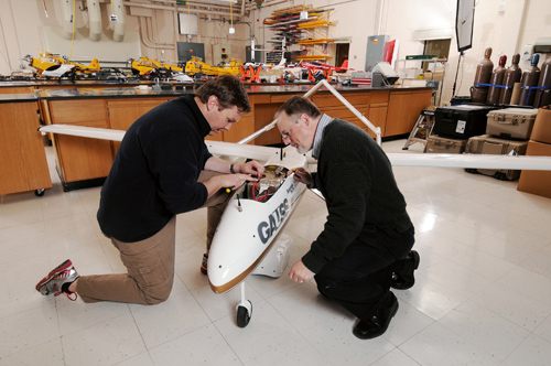 Research engineers Warren Lee (left) and Mike Heiges adjust GTRI's Airborne Unmanned Sensor System (GAUSS.) (GT Photo by: Gary Meek)