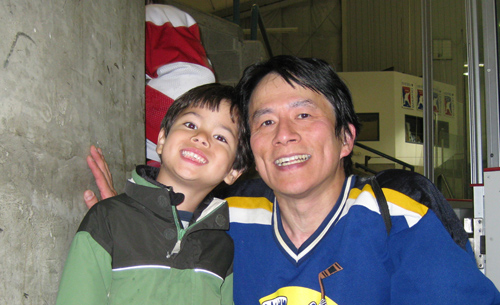 """Calvin Hsia, pictured here with his son Tyler, started Microsoft's MVP program 20 years ago as a simple list of """"most verbose"""" people on a forum. Image credit: Microsoft"""