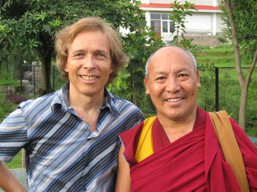 Chris Impey stands with the Venerable Geshe Lhakdor, director of the Library of Tibetan Works, who was for longer than a decade the personal translator for the Dalai Lama. (Photo by: Karma Thupten)