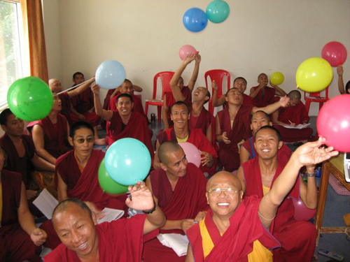 """Monks release their """"universes"""" after an experiment to measure Hubble expansion using balloons as analogs for curved space-time. (Photo by: Chris Impey)"""
