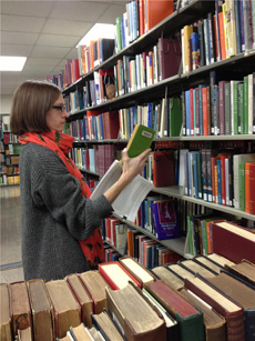 Dayna Topalian, of MSU Libraries, pulls titles to be shipped to Google for digitization. Image credit: Michigan State University