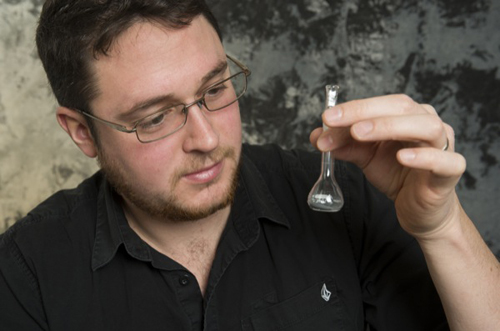 UD researcher Erik Koepf holds a vial with solar fuel. Photos by Kathy F. Atkinson and courtesy of Erik Koepf