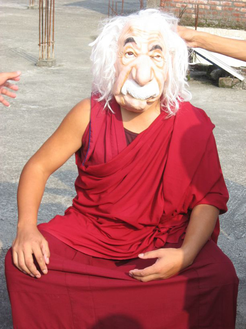 Ngawang Lobsang dons the mask of Einstein after the master of space and time appeared in the classroom to answer questions about relativity. (Photo by: Chris Impey)