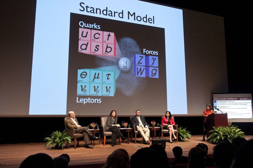 Panelists explain the science behind the Higgs particle, which underpins the so-called Standard Model upon which the modern study of physics is based. Photo by Lloyd DeGrane