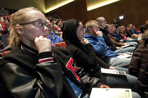 The University invited science teachers from several Chicago area high schools to attend three full-day workshops at Argonne, Fermilab and the University of Illinois to help them prepare their students for the culminating panel presentation at the Reva and David Logan Center for the Arts. Busloads of students and educators from Lockport Township, Oak Lawn Community High School, Pritzker College Prep and Rossville High School came to the Higgs boson event. Photo by Lloyd DeGrane