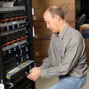 New IBM Power Systems for Small Businesses. IBM technician Steve Mallmann performs a quality check on a new IBM Power 740 Express system infused with the latest POWER7+ chip technology. IBM unveiled new Power Systems for SMBs and growth market companies tuned for big data and cloud computing. (image credit: IBM)