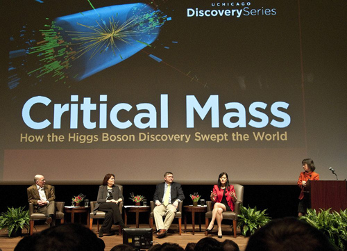 """Experts who gathered for the University's first Discovery Series panel discussion, """"Critical Mass: How the Higgs Boson Swept the World,"""" respond to Professor Young-Kee Kim, moderator for the Feb. 7 event. The panelists are (seated, from left) Prof. Mark Orgelia, Fermilab Senior Scientist Patricia McBride, Argonne physicist Tom LeCompte, and Prof. Marcela Carena, who also is a senior theoretical physicist at Fermilab. Photo by Lloyd DeGrane"""
