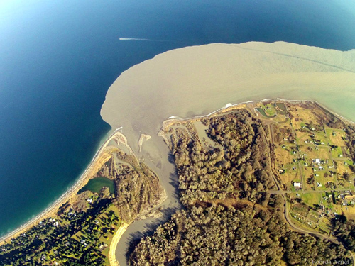 A century of accumulated sediment fans out at the Elwha river mouth.  Image credit: Tom Roorda