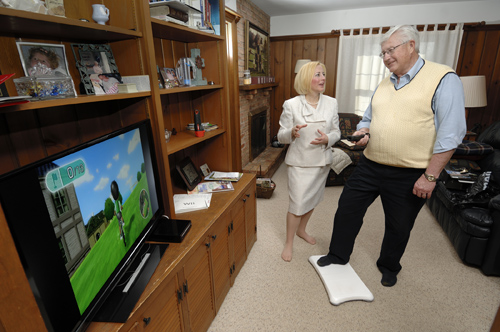 Amy Hoffman, MSU assistant professor of nursing, helps John Cisco exercise using the Nintendo Wii as part of his rehabilitation after surgery for lung cancer. Photo by Harley Seeley.