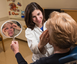 Flora Levin, MD, discusses a blepharoplasty procedure with a patient. Photo by Robert Lisak