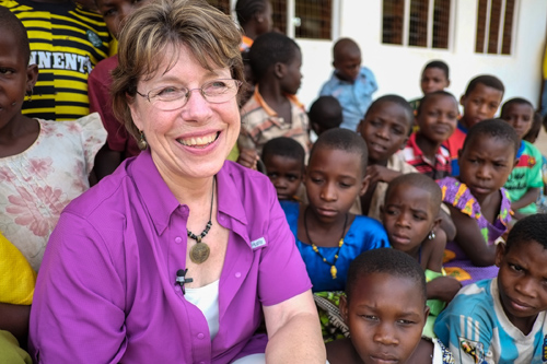 Milola children greet Diane Ruonavaara, project manager for MSU's Tanzanian Partnership Program. Photo by Gabrielle Kleber