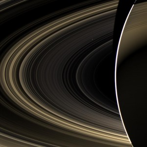 Peering over the shoulder of giant Saturn, through its rings, and across interplanetary space, NASA's Cassini spacecraft spies the bright, cloudy terrestrial planet, Venus. The vast distance from Saturn means that Venus only shows up as a white dot, just above and to the right of the image center. Image credit: NASA/JPL-Caltech/Space Science Institute (Click image to enlarge)