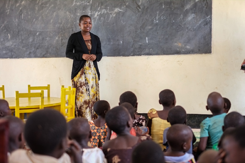 A teacher talks to her students in the new pre-primary school in Ngwenya, a sub-village of Milola. Photo by Gabrielle Kleber