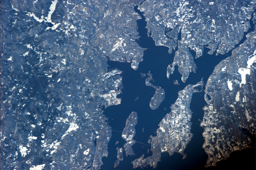 Rhode Island on a clear day. Commander Ford photographed Narragansett and Mt. Hope bays from the International Space Station. His adult kids watched him fly by from the Ladd Observatory, near the top edge of the photo, just right of center. Image credit: Brown University