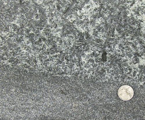 Coarse grain segregation in sheet-like basalt near Rapidan, Va.; elements have crystallized. Image credit: Terrence Blackburn and Paul Olsen