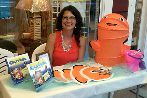 """Stephanie Guzman, a UD alumna, is writing a series of children's books called """"The Adventures of Oliver the Clownfish"""" to help children deal with typical challenges in their lives. Image credit: University of Delaware"""