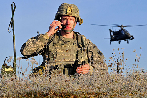 U.S. Army soldier on a field telephone in 2011. Image credit: Master Sgt. Robert Hyatt, U.S. Army, Wikimedia Commons