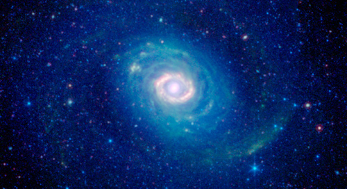 How many rings do you see in this new image of the galaxy Messier 94, also known as NGC 4736? While at first glance one might see a number of them, astronomers believe there is just one. This image was captured in infrared light by NASA's Spitzer Space Telescope. Image credit: NASA/JPL-Caltech