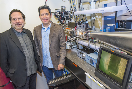 John Tainer (left) and Rob Rambo at the SIBYLS beamline of the Advanced Light Source have developed new metrics that dramatically improves data analysis for small angle scattering (SAS) experiments. (Photo by Roy Kaltschmidt, Berkeley Lab)