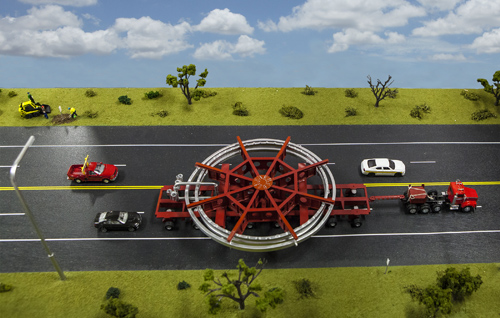 A model of the truck that will be used to transport the Muon g-2 ring, placed on a streetscape for scale. The truck will be escorted by police and other vehicles when it moves from Brookhaven National Laboratory in New York to a barge, and then from the barge to Fermi National Accelerator Laboratory in Illinois. Image credit: Fermilab