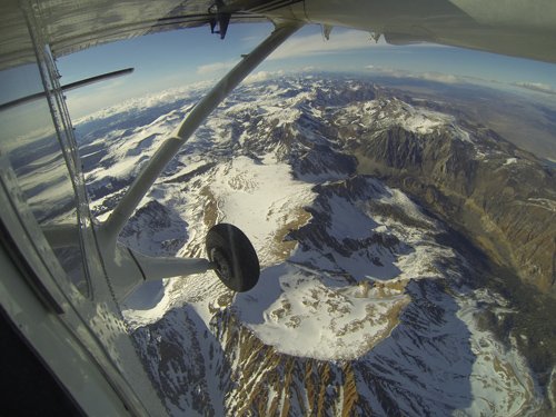 Mt. Dana and Dana Plateau in the Tuolumne River Basin within Yosemite National Park, Calif., as seen out the window of a Twin Otter aircraft carrying NASA's Airborne Snow Observatory on April 3, 2013. The patchy snow cover this early in the snowmelt season is a reflection of the poor snowfall in the Sierra Nevada this winter and spring. The Airborne Snow Observatory is producing comprehensive weekly maps of how much water this basin holds, data that will be used to estimate how much water will flow out of the basins when the snow melts. The watershed and its Hetch Hetchy Reservoir are the primary water supply for San Francisco. Image credit: NASA/JPL-Caltech