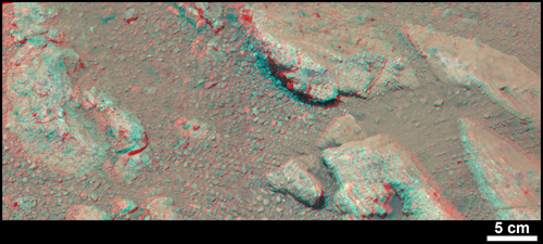 "This stereo view from NASA's Mars rover Curiosity shows a rock called ""Link,"" which bears rounded pebbles that provide evidence about vigorous flow of water in a stream on ancient Mars. The scene appears three dimensional when viewed through red-blue glasses with the red lens on the left. The scale bar at lower right is 5 centimeters (2 inches). Image credit: NASA/JPL-Caltech/MSSS"
