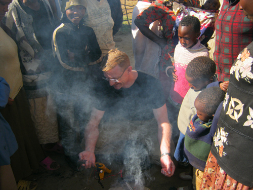 Jacobson demonstrates the VOTO charger in Kenya. (Kenya photos courtesy of Jacobson)