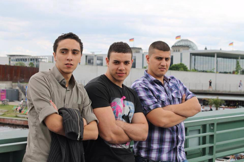 Hossam with friends (center): 'I would say, for me, I am romantic because of my experiences with the girls'.