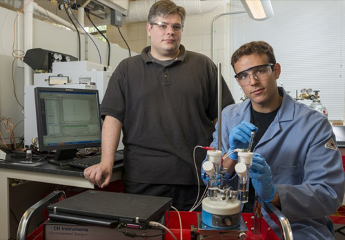 Joel Rosenthal (left) and doctoral student John DiMeglio at work in Rosenthal's lab in the UD Department of Chemistry and Biochemistry. Photo by Kathy F. Atkinson
