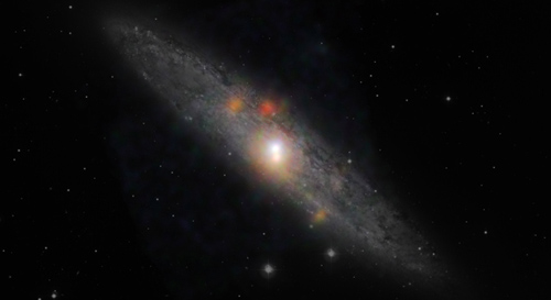 The Sculptor galaxy is seen in a new light, in this composite image from NASA's Nuclear Spectroscopic Telescope Array (NuSTAR) and the European Southern Observatory in Chile. Image credit: NASA/JPL-Caltech/JHU