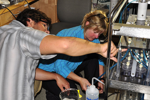 Postdoctoral investigator Bill Orsi and WHOI microbial ecologist Virginia Edgcomb, seen here working on a deep-sea robotic incubator, have been pursuing ways to sample and study microorganisms that live in extreme environments. (Photo by Cherie Winner, Woods Hole Oceanographic Institution)