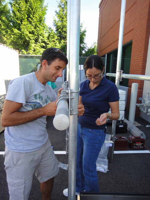Domenico Mangione (Italy) and Celina Kattan (El Salvador) assemble the framework of a telemetry station in the parking lot of the USGS Cascades Volcano Observatory. Image credit: U.S. Geological Survey