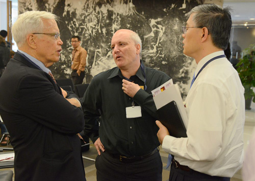Professors James Heckman (left to right), Steven Durlauf and Dali Yang talk during a break in the Conference on the Study of Inequality. Photo by James Withrow