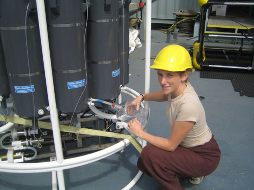 Karin Holmfeldt, the study's first author, aboard a research vessel sampling viruses in the Atlantic Ocean. (Photo by: Marie Louise Kjaergaard Schroter)