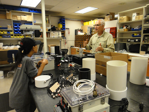 USGS volcano scientist, Andy Lockhart discusses telemetry options with Syegi Kunrat of Indonesia. Image credit: U.S. Geological Survey