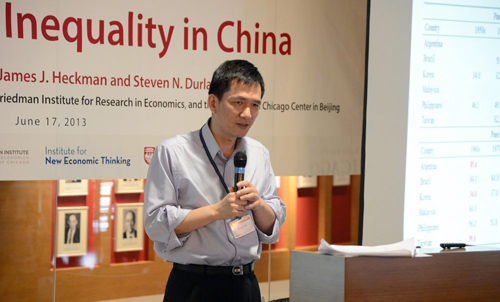 Yang Yao, professor and director of the China Center for Economic Research at Peking University, gave the keynote address at a June 17 conference at the University of Chicago Center in Beijing. Photo by James Withrow