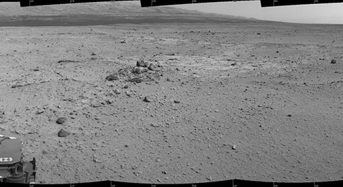 This mosaic of images from the Navigation Camera (Navcam) on NASA's Mars rover Curiosity shows the scene from the rover's position on the 376th Martian day, or sol, of the mission (Aug. 27, 2013). The images were taken right after Curiosity completed the first drive during which it used autonomous navigation on unknown ground. Image credit: NASA/JPL-Caltech