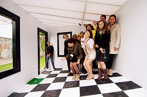 """Chris Larson's class in their creation, """"The Ames Room."""" Image credit: University of Minnesota"""
