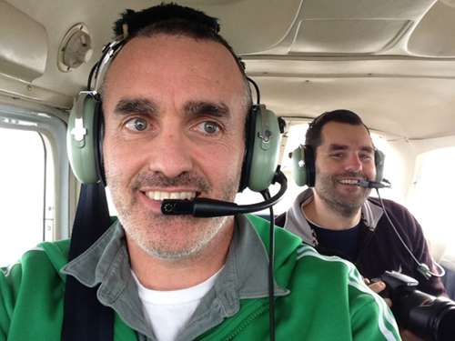 Co-authors Chris Reddy, foreground, and Dave Valentine during an overflight of the affected area in January 2013. (Photo courtesy Chris Reddy, Woods Hole Oceanographic Institution)