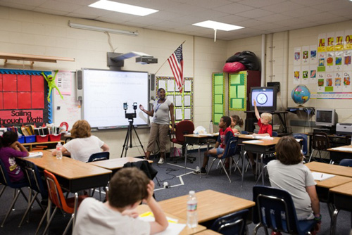 A teacher engages with students in a classroom. Image credit: U-M Measures of Effective Teaching Project.