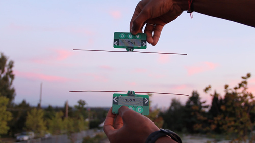 Researchers demonstrate how one payment card can transfer funds to another card by leveraging the existing wireless signals around them. Ambient RF signals are both the power source and the communication medium. Image credit: University of Washington