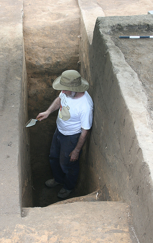 Rob Beck at base of cross-sectioned Spanish moat, moat is 1.7 m (5.5 feet) deep and 4.5 m (15 feet) across