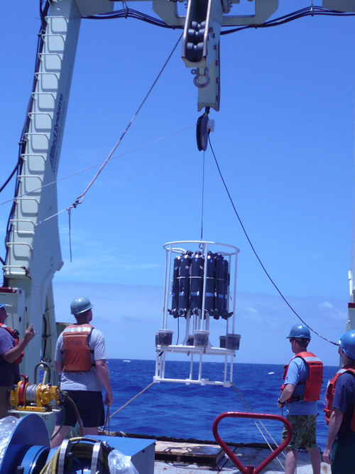 Aboard the R/V Knorr, WHOI researchers Carl Lamborg, Tyler Goepfert, and Chad Hammerschmidt deploy a trace metal rosette on five kilometers of non-metallic line to gather samples of seawater from the depths of the South Atlantic Ocean. (Photo courtesy Emily Nahas, Univ. of Washington)