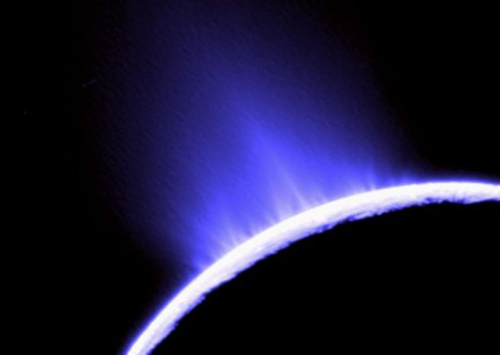 Scientists correlate the brightness of the Enceladus plume to the amount of solid material, including water ice and hydrocarbons, being ejected from fissures in the moon's icy surface. (Image credit: NASA/JPL)