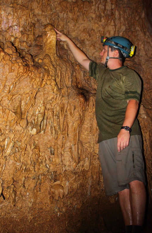 Jud Partin inspects a stalagmite in Taurius Cave on the island of Espiritu Santo, Vanuatu. A stalagmite such as this one could be used in a paleoclimate reconstruction. Image credit: University of Texas at Austin