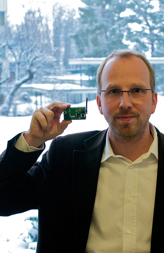 In this photo, Dr. Thorsten Kramp, research staff member and co-developer of Mote Runner at IBM Research - Zurich, holds a mote programmed with Mote Runner to detect movement and light. IBM scientists made available a free software development kit, called Mote Runner, to help proliferate the use of sensor networks as a means of collecting data, including climate readings, building and facility management, and water distribution, which can then be analyzed and understood to make more accurate predictions and faster decisions. Photo courtesy of Michael Lowry