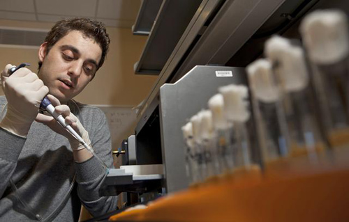 """Lead author Yiannis Savva. An unintended discovery of ADAR on a site of chromosome four in fruit flies, said his thesis adviser, would be """"either an artifact or ... the centerpiece of your thesis."""" Image credit: Brown University"""