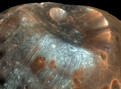 A mysterious little rock in its own right. The Martian moon Phobos has accumulated dust and debris from the surface of Mars, knocked into its orbital path by projectiles colliding with the planet. A sample-return mission to Phobos would thus return material both from Phobos and from Mars. Image credit: NASA